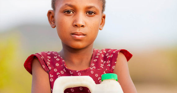 Young kid holding a bottle of water