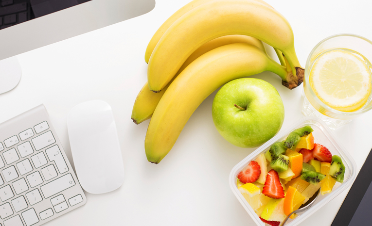 Healthy fruits next at a workspace