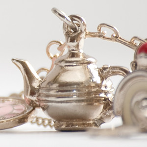 Charms and a teapot